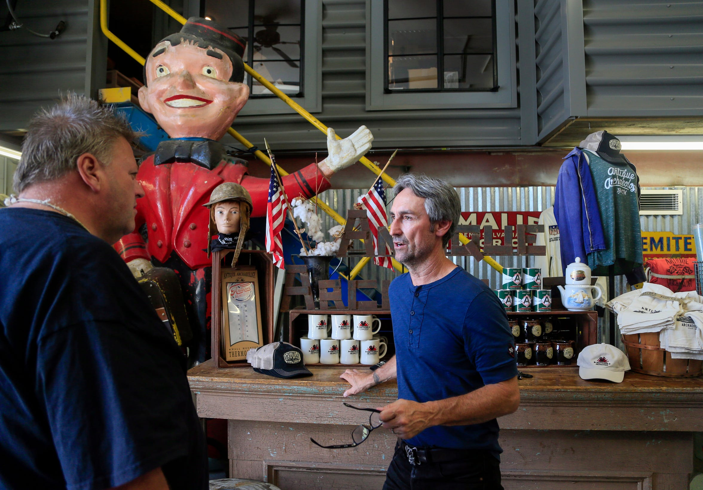 Celebrity Culture: Mike Wolfe of American Pickers fame chats with customers at his store Antique Archaeology in LeClaire June 27, 2018.