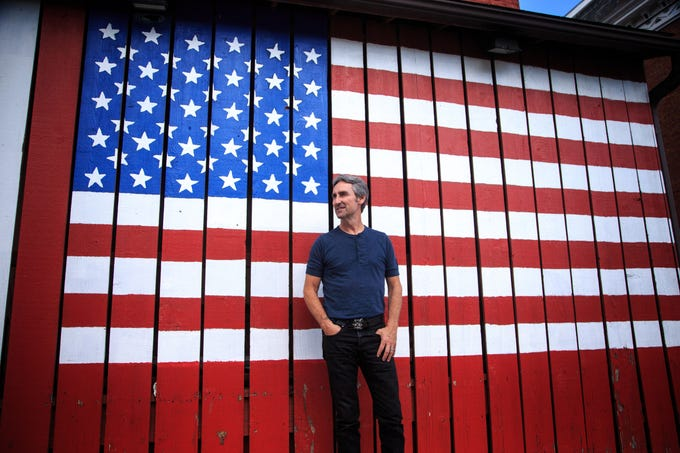 Celebrity Culture: Mike Wolfe of American Pickers fame stands for a photo in LeClaire, where his store Antique Archaeology is located June 27, 2018.