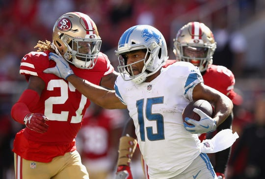 Detroit Lions WR Golden Tate runs away from San Francisco 49ers DB Adrian Colbert at Levi's Stadium on Sept. 16, 2018 in Santa Clara, Calif.
