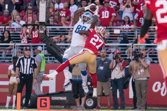 Detroit Lions tight end Michael Roberts catches a touchdown against San Francisco 49ers defensive back Adrian Colbert in the fourth quarter at Levi's Stadium on Sept. 16, 2018.
