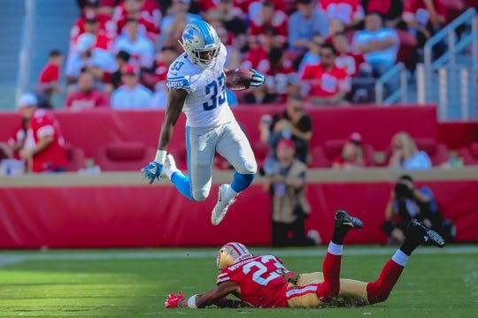 Detroit Lions running back Kerryon Johnson hurdles San Francisco 49ers cornerback Ahkello Witherspoon during the fourth quarter at Levi's Stadium on Sept. 16, 2018.