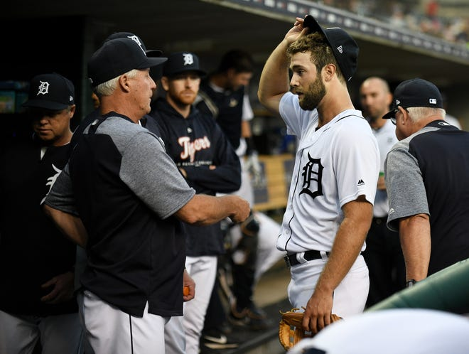 Tigers pitching coach Rick Anderson talks with pitcher Daniel Norris, right, after the top of the first inning.