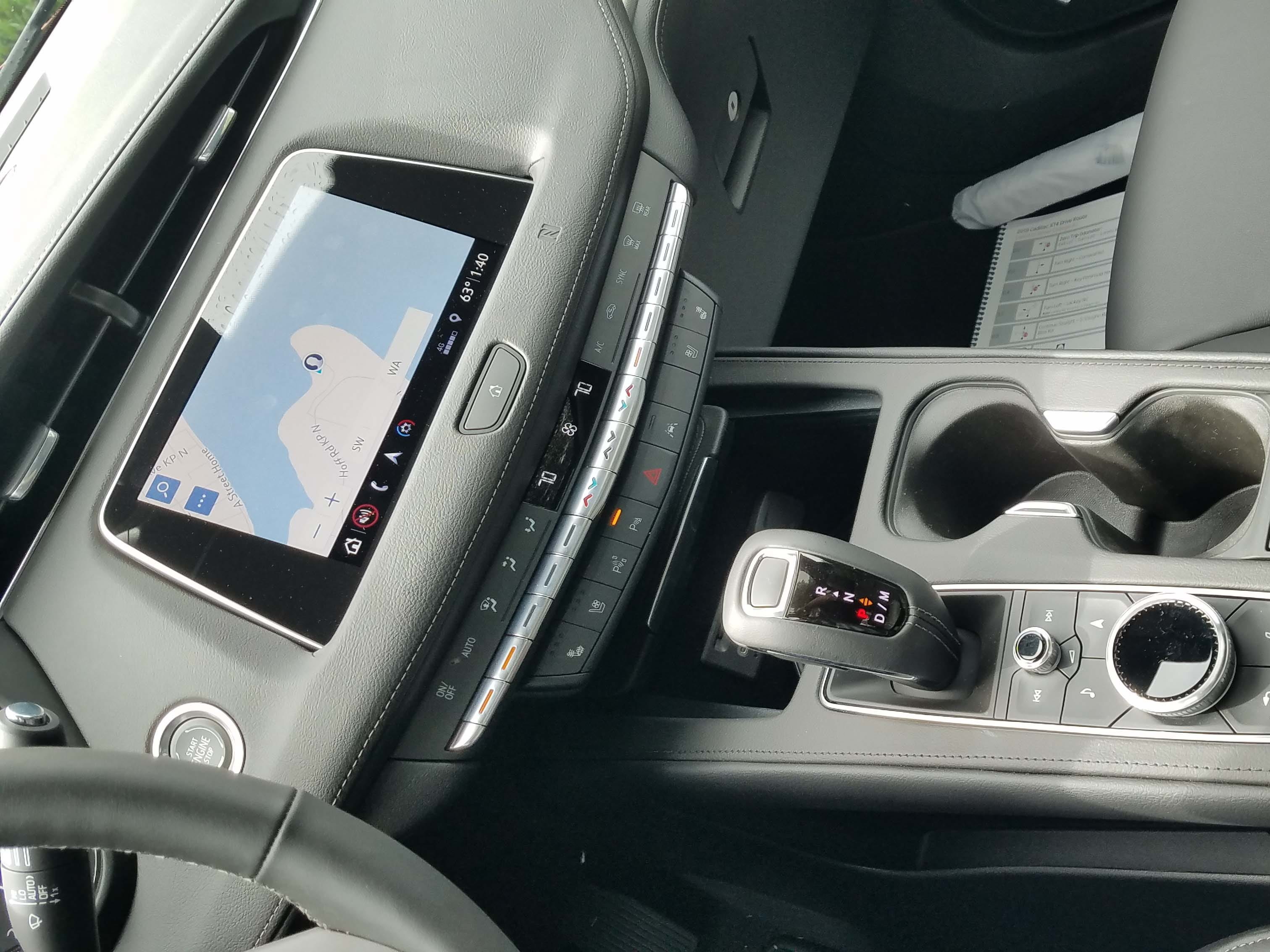 Room to spare. The 2019 Cadillac XT4 ute features a cleverly engineered center console that can hold two cups, monostable shifter, drive controls and useful cubby space.
