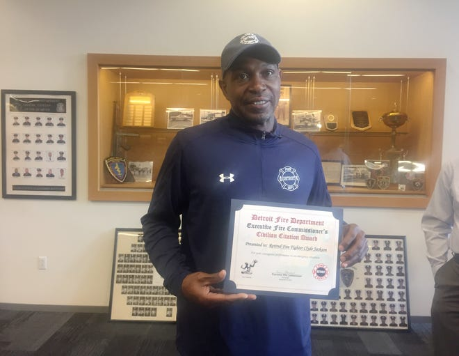 Firefighter Clyde Aaron Jackson, now retired, received an award Tuesday from the Detroit Fire Department for his rescue efforts in saving people from a house fire in August.