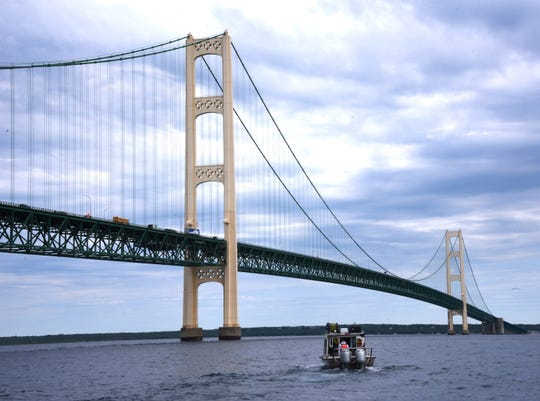 Oil pipeline operator Enbridge moves under the Mackinac Bridge on their way to inspect their controversial Line 5 under the Straits of Mackinac Wednesday, June 8, 2016. Using an autonomous underwater vehicle and a roving underwater  vehicle over several days, the entire five-mile-long pipeline, which rests on supports along the bottom of Lake Michigan,will have been covered by both sonar and visual means.