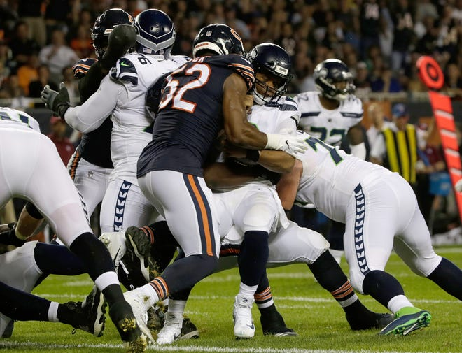 Chicago Bears linebacker Khalil Mack sacks Seattle Seahawks quarterback Russell Wilson (3) during the first half. Chicago defeated Seattle 24-17.