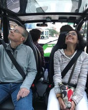 Riders take a trip on May Mobility's self-driving shuttles in downtown Detroit.