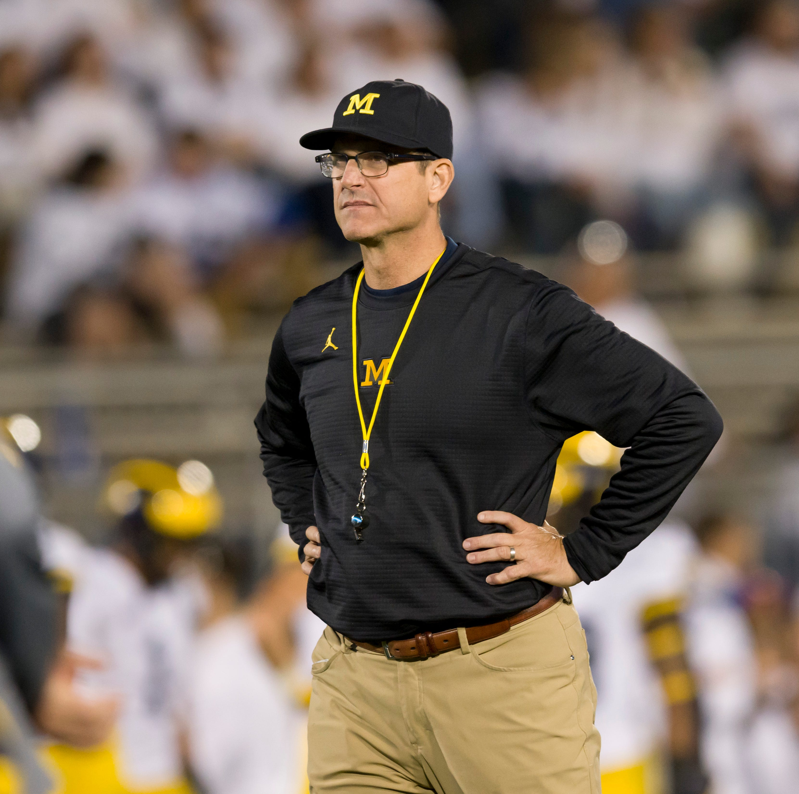 Harbaugh says coaching at alma mater 'a thrill'