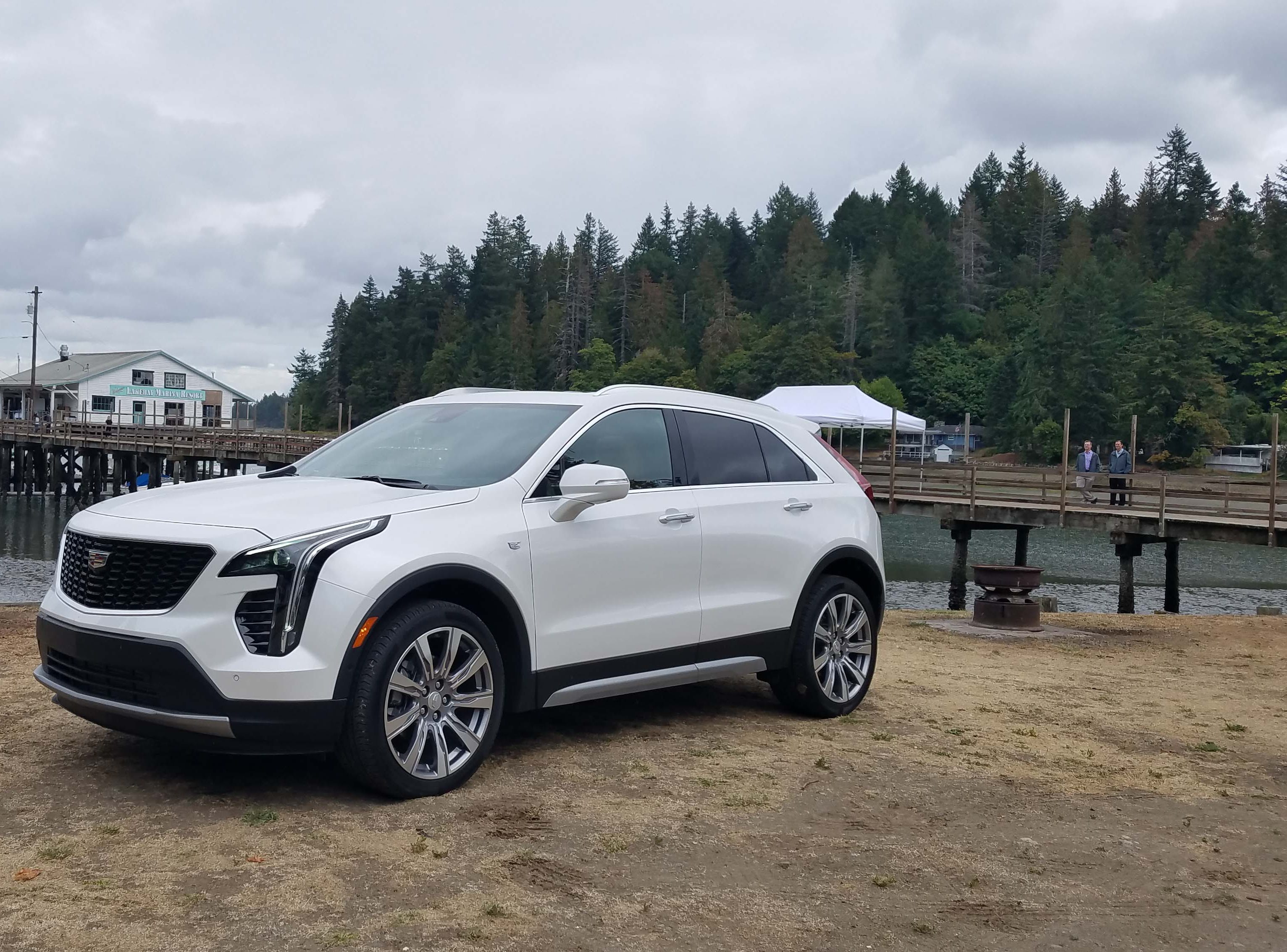A white, 2019 Cadillac XT4 shows off the wee ute's tasteful styling cues at a dock near Bremerton, Washington.