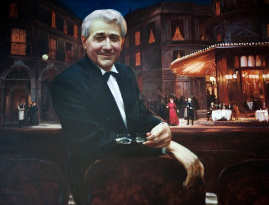 This painting of Michigan Opera Theatre founder and general director David DiChiera by Ming Qin was a gift to DiChiera from Barbara and Herman Frankel on the 30th anniversary of the MOT (1971-2001) and hangs above the fireplace in the Herman and Barbara Frankel Lounge inside the Detroit Opera House.