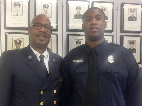 Darrell Freeman II, 25, and his father, Darrell Freeman Sr, 54, both of Detroit. Son received commendation for assisting in saving life of a grandmother suffering heart attack in her home. Father is senior chief of Detroit Fire Dept and said he runs the day to day operations.