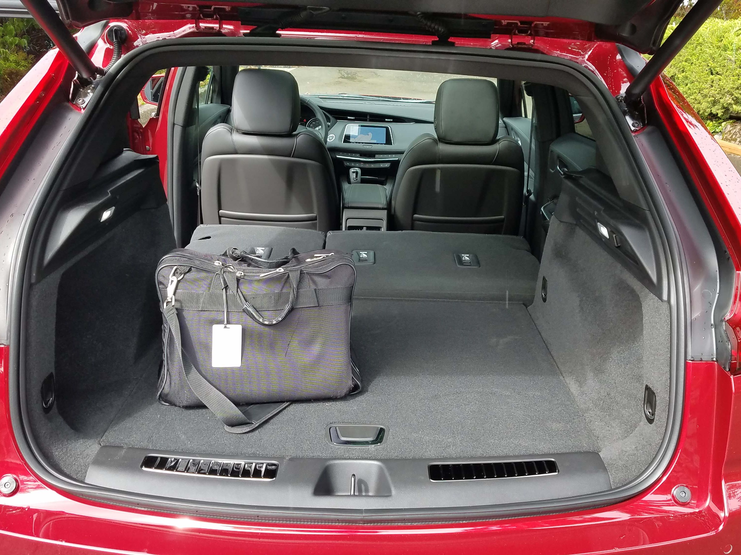 Despite a raked, sporty rear roof and best-in-class rear leg room, the 2019 Cadillac XT4's rear hatch provides adequate space to store two golf bags.