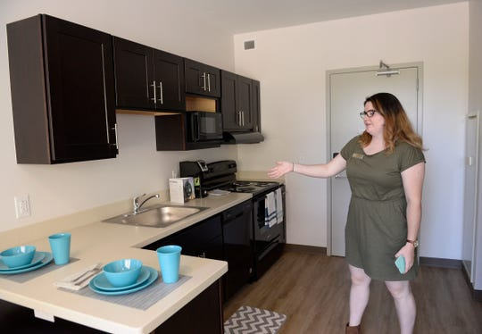 Maggie Nelson, 24, marketing Assistant, Student Auxilary Services at Wayne State, shows a second floor apartment inside the new Anthony Wayne Apartments on campus.