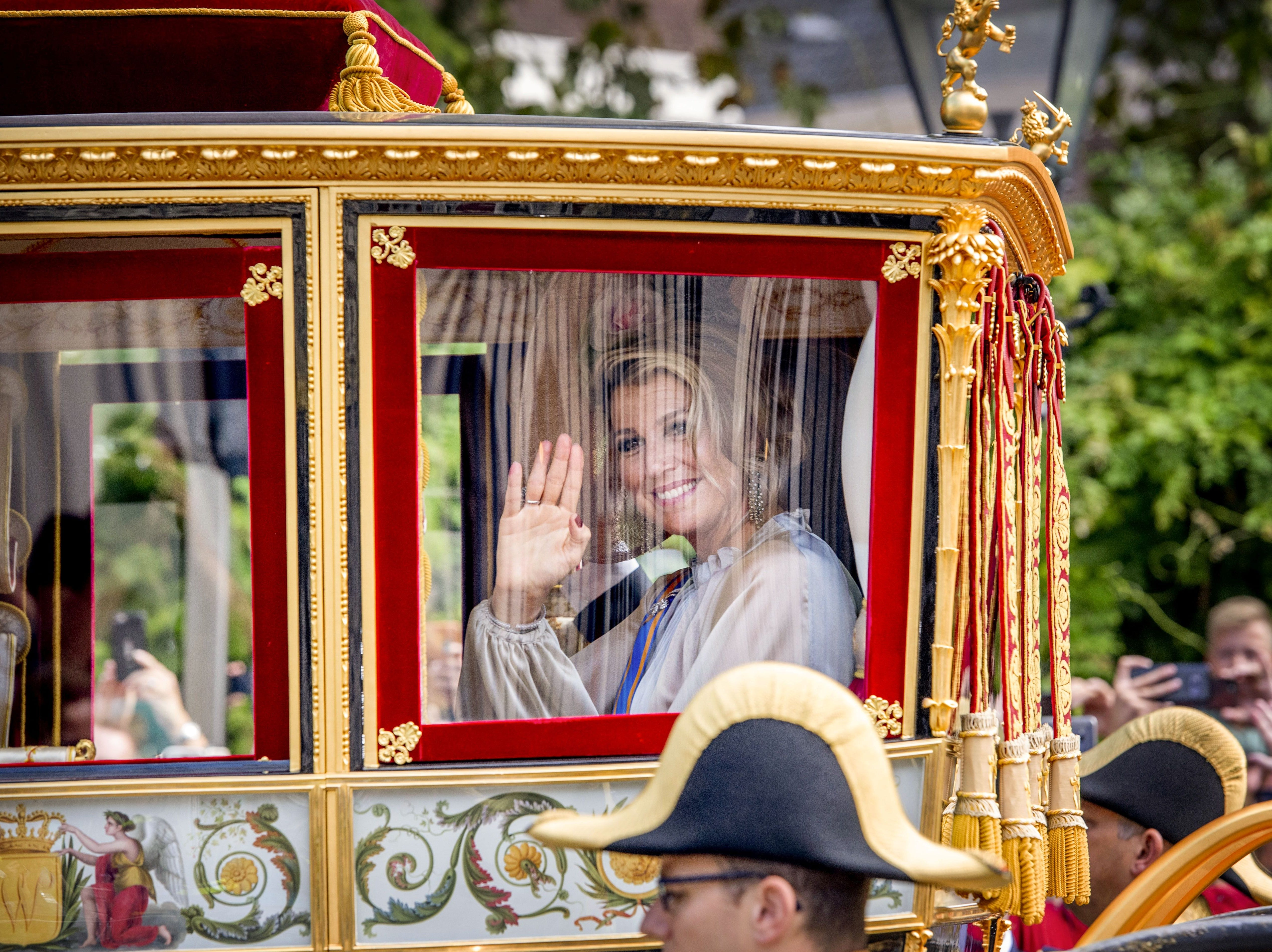 Dutch Queen Maxima waves as she arrive at the Ridderzaal in The Hague, on September 18, 2018. - Prince's Day is the traditional opening of the Dutch parliamentary year, when the King delivers the 'Speech from the Throne' in the Ridderzaal (Knights' Hall).