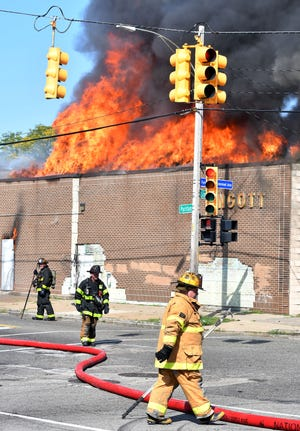Firefighters work a blaze at a commercial building on Puritan at Linwood in Detroit on Tuesday.