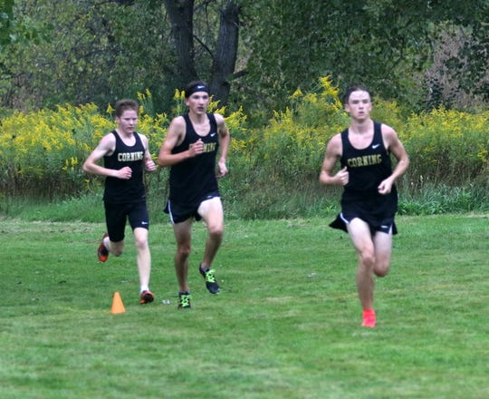 Corning runners, from right, Bryce Derick, Nathan Lawson and Torrey Jacobson-Evans near the finish line in the boys race at the STAC West championship meet Sept. 17, 2018 at Sperr Memorial Park in Big Flats, Derick was first, Lawson second and Jacobson-Evans third.