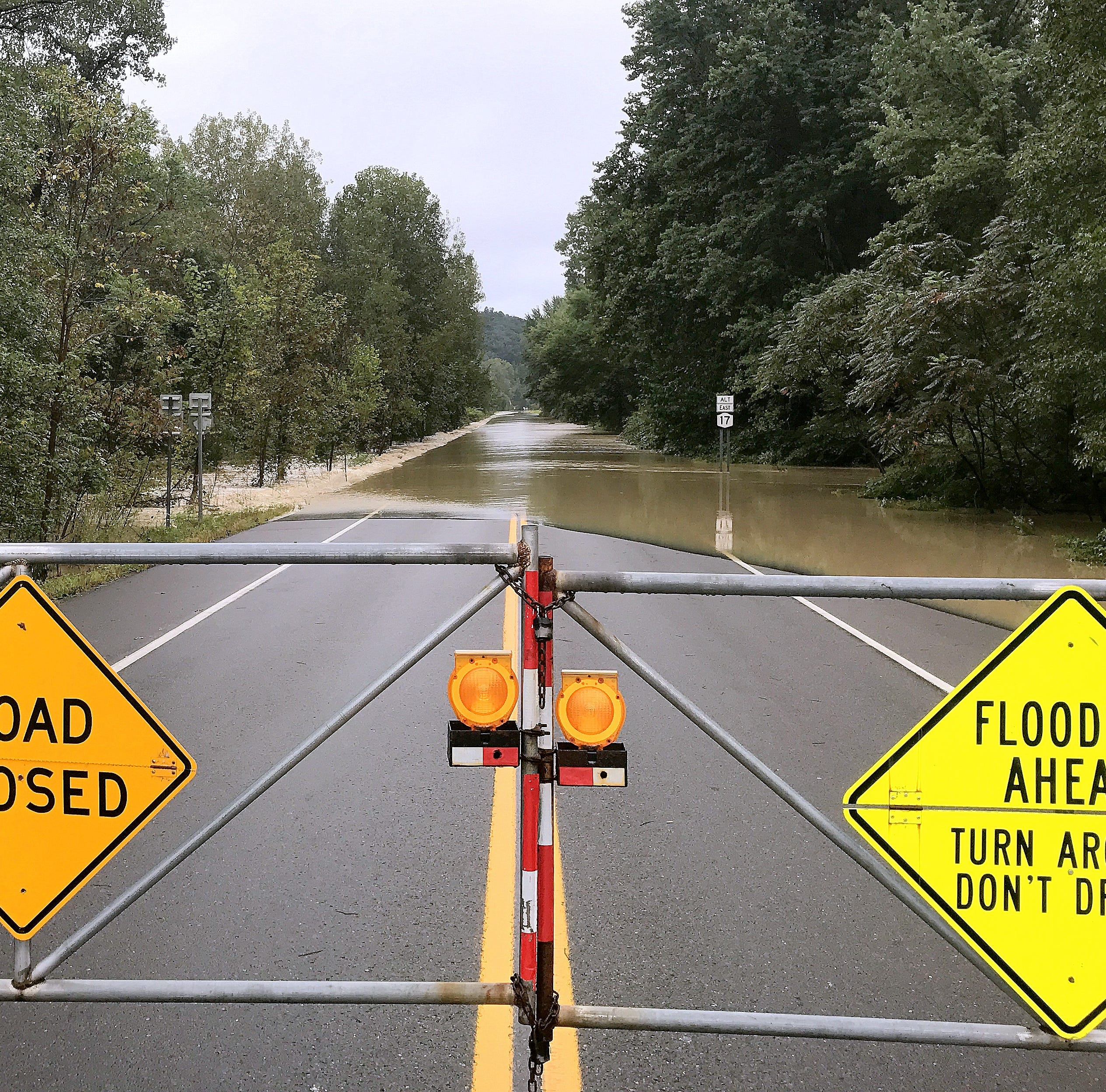 Flood waters surge over the Wellsburg-Lowman crossover Tuesday morning in southeastern Chemung County.