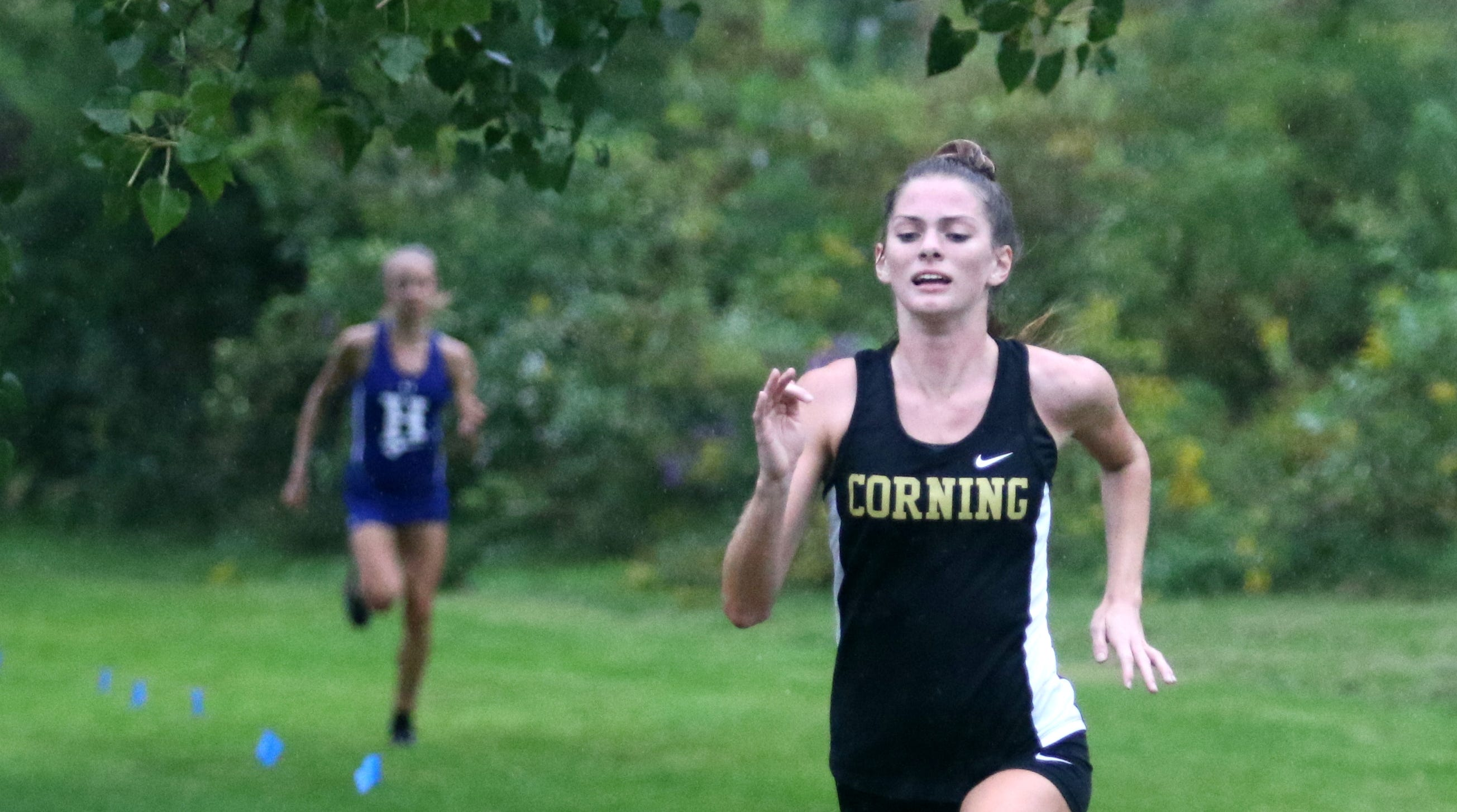 Girls winner Lindsey Butler of Corning nears the finish line, with Horseheads' Maddie Klein behind her in second, at the STAC West cross country championship meet Sept. 17, 2018 at Sperr Memorial Park in Big Flats.