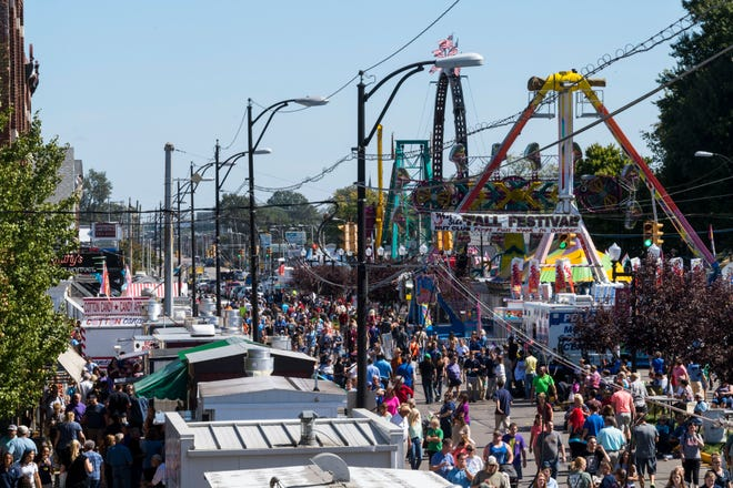 People attend the 96th annual West Side Nut Club Fall Festival along West Franklin Street in Evansville, Ind., around lunchtime on Monday, Oct. 2, 2017. The street festival will continue all week long until late Saturday evening, October 7, 2017.