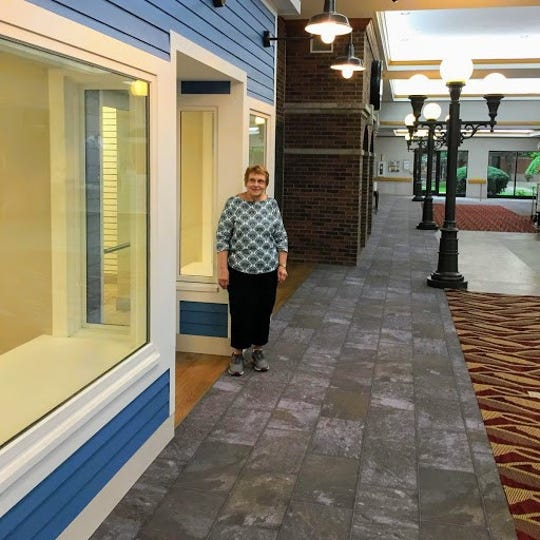 Riverview Auxiliary President Karen Schanke stands outside the new home for the gift shop which will soon be open.