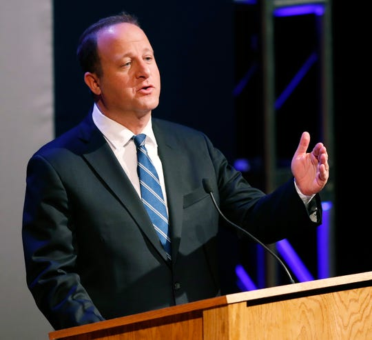 Colorado Democratic gubernatorial candidate Jared Polis responds to a question during a televised debate in Denver in this June 18, 2018, file photo.