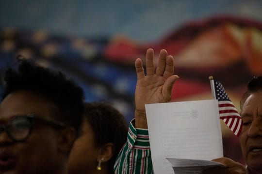 Newly naturalized citizen pledge allegiance to the United States of America during the Naturalization Oath Ceremony held at the U.S. Citizenship and Immigration Services office at Fort Myers on Sept. 18, 2018.