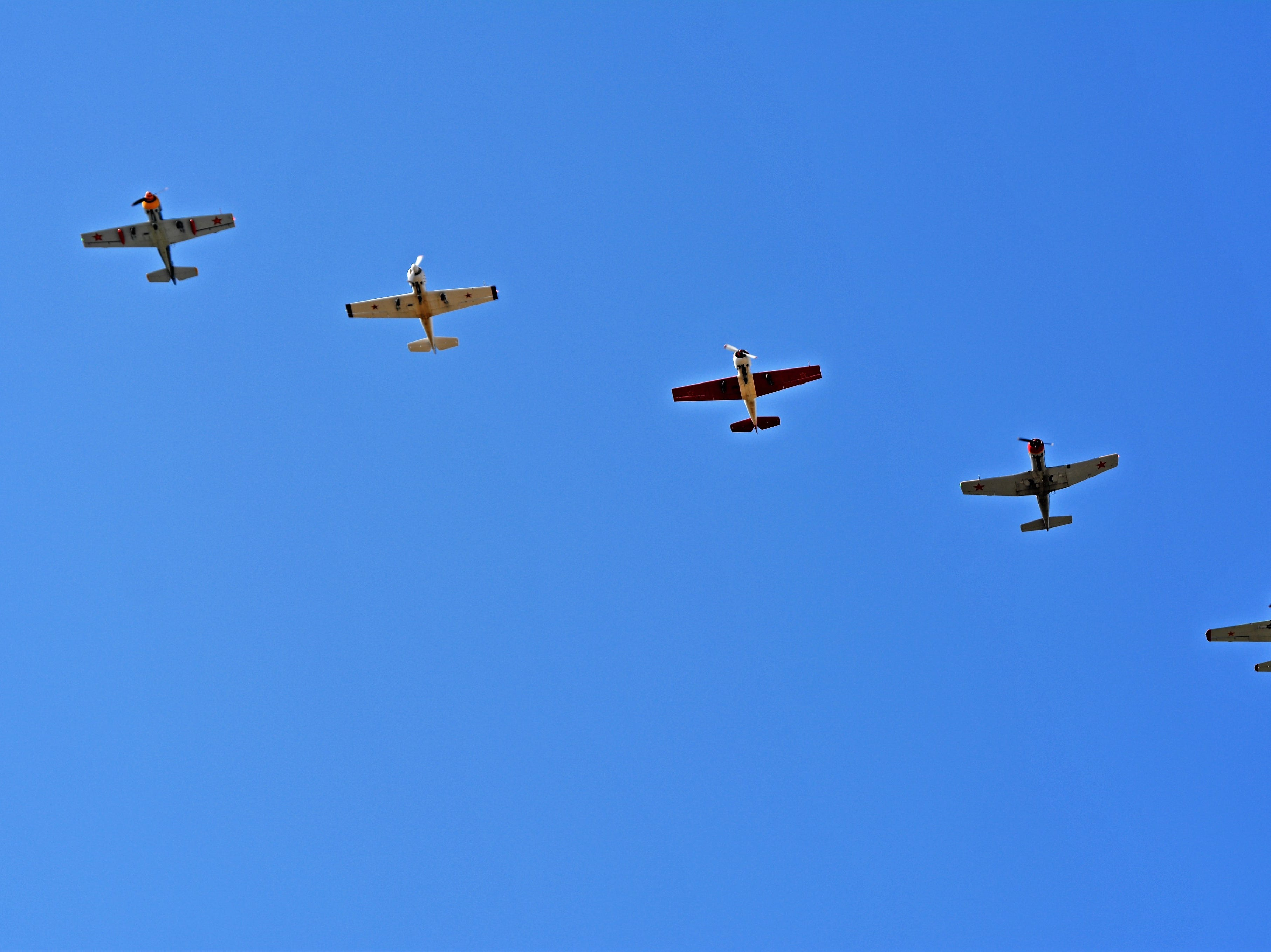 Planes fly in formation as part of a re-enactment during the Oconto Fly-in, Car & Tractor Show on Sept. 15 at the Oconto-J. Douglas Bake Municipal Airport.