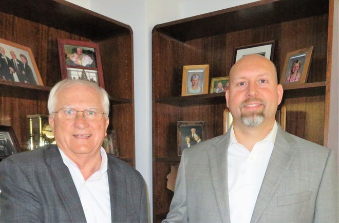 Chad Schuettpelz, right, is the new president and general manager of Maple Valley Mutual, succeeding Al Schuettpelz, left, who continues as CEO and serving on the board of directors.