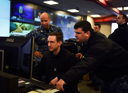 Sailors Stand Watch At Fleet Cyber Command