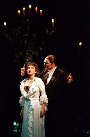 """Rebecca Pitcher stars as Christine Daae and Brad Little is the Phantom during """"The Phantom of the Opera"""" in 1999 at the Weidner Center."""