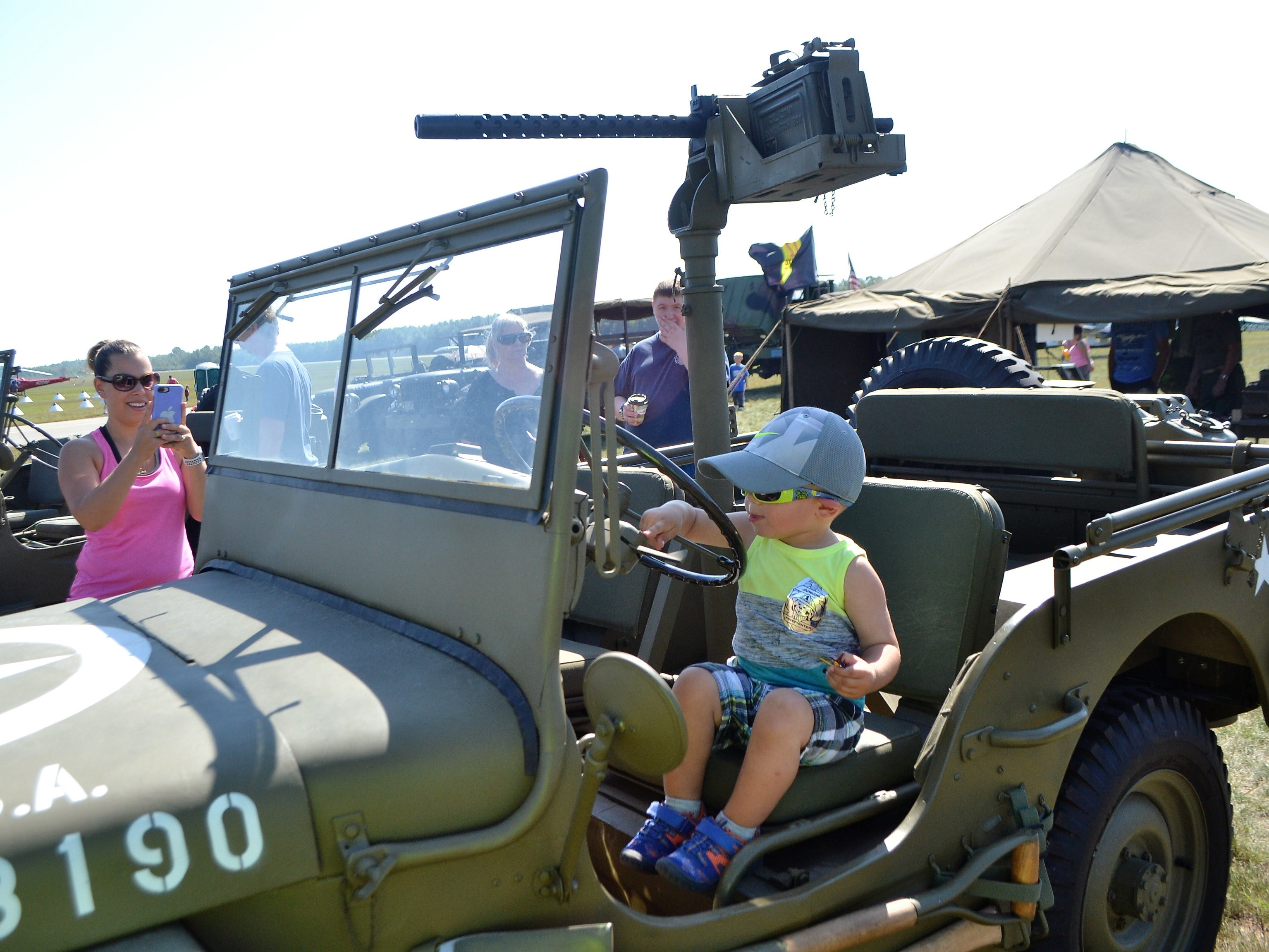 Emmett Steppe, 2, of Oconto Falls, sits behind the wheel of a WWII Army Jeep at the Oconto Fly-in, Car & Tractor Show on Sept. 15 at the Oconto-J. Douglas Bake Municipal Airport.