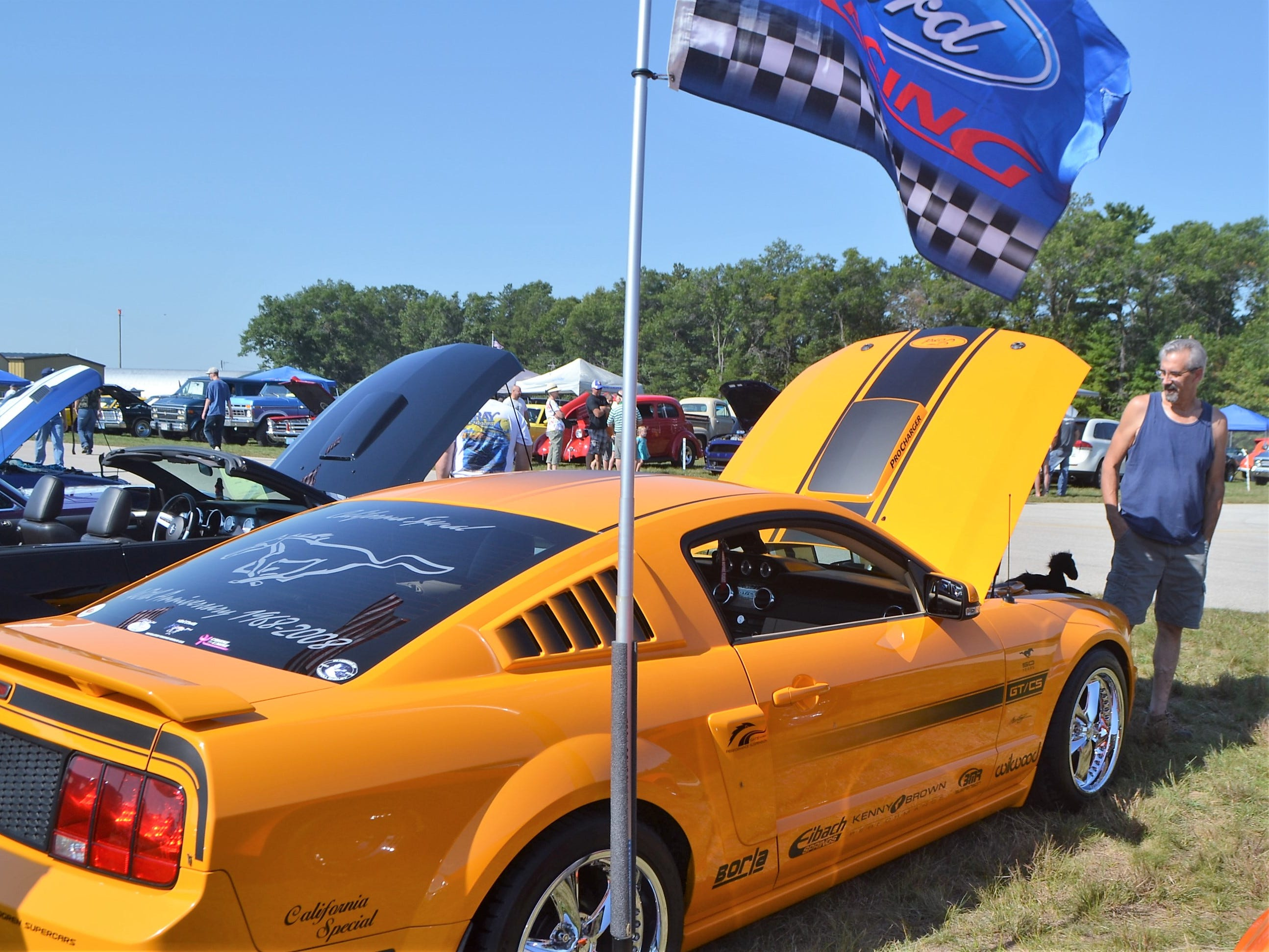 John Duca of Coleman admires a customized 2008 Mustang at the Oconto Fly-in, Car & Tractor Show on Sept. 15 at the Oconto-J. Douglas Bake Municipal Airport.
