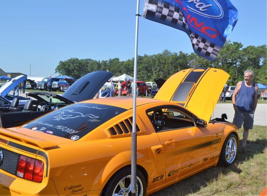 John Duca of Coleman admires a customized 2008 Mustang at the Oconto Fly-in, Car & Tractor Show last September. This year's event at the Oconto-J. Douglas Bake Municipal Airport is Saturday.