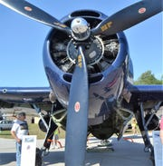Richard Faccio of Norway, Michigan, checks out the TBM Avenger, a WWII plane, at the at the Oconto Fly-in, Car & Tractor Show last Septmber at the Oconto-J. Douglas Bake Municipal Airport. This year's show is Sept. 21.