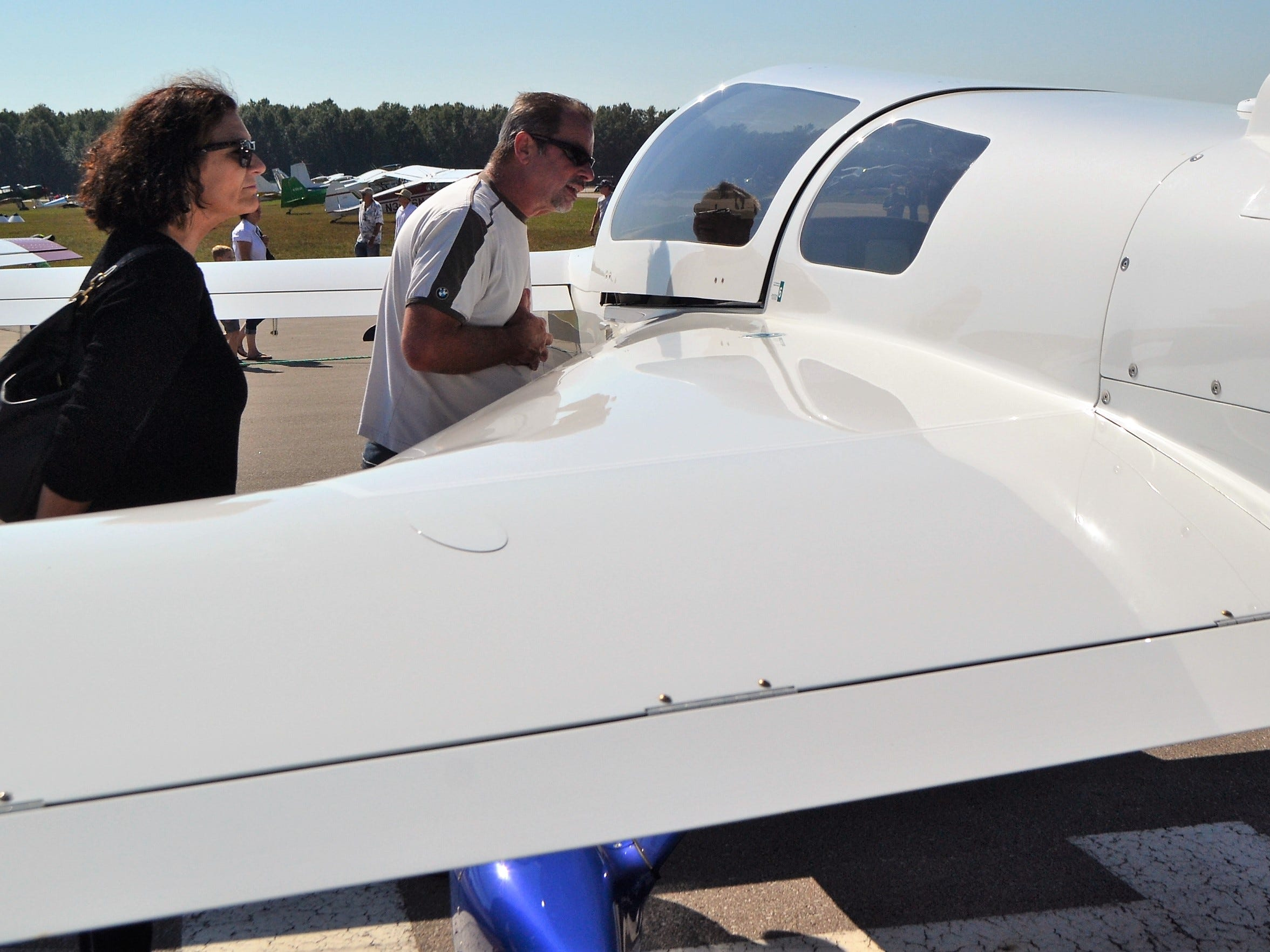 Todd Robbins of Green Bay takes a look inside the cabin of a Rutan N403R, a home-built aircraft, at the Oconto Fly-in, Car & Tractor Show on Sept. 15 at the Oconto-J. Douglas Bake Municipal Airport. At left is his wife, Roberta Robbins.
