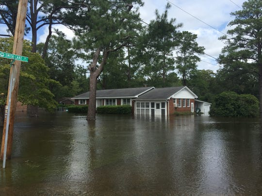 A house is flooded on Busbee Street in Conway on Monday, Sept. 17, 2018.