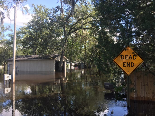 Waters rise from the Waccamaw River to overcome the streets and homes at Pitch Landing in Conway on Tuesday, Sept. 18, 2018.
