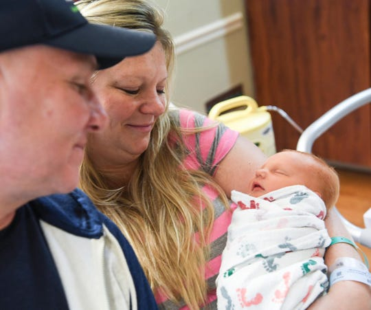 Nicole Summer of Myrlte Beach, evacuated from Myrtle Beach, delivered baby girl Nicolina near her husband Nicholas, resting at St. Francis Eastside in Greenville on Tuesday, September 18, 2018. (Ken Ruinard / Greenville News / Gannett USA Today Network / 2018 )