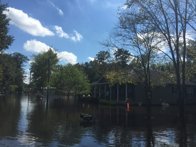 Flood waters from the Waccamaw River due to Hurricane Florence rise around Whitney Hall's home in Conway on Tuesday, Sept. 18, 2018.