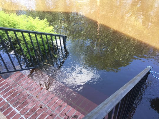 Water creeps up the front steps at Whitney Hall's home on Pitch Landing Drive in Conway on Tuesday, Sept. 18, 2018.