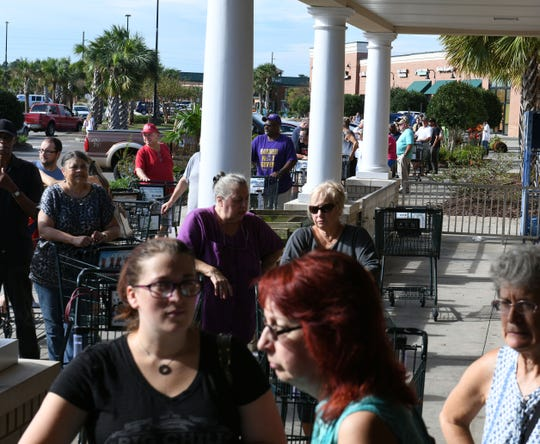 Residents of Leland and Wilmington, N.C., are dealing with lines at stores, like this Harris Teeter, that have been able to open following Hurricane Florence on Sept. 18, 2018.