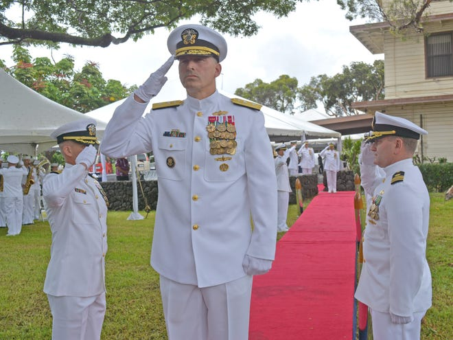 Rear Adm. John Adametz assumes command at NAVFAC Pacific during a Change of Command Ceremony held Sept. 13 at its headquarters.