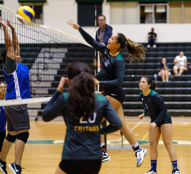The University of Guam Tritons' Muñeka Taisipic spikes on the UOG Trident Team in a Guam Women's College Volleyball League match Sept. 17 at the UOG Calvo Field House.