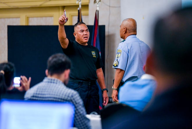 Highway Patrol Division Officers Julian Laxamana, left, and A.S. Bueno demonstrates the proper technique in administering one of several standardized field sobriety tests during a two-week drunk and drug driving training program, involving local and federal law enforcement personnel, at the Pacific Star Resort & Spa in Tamuning on Tuesday, Sept. 18, 2018.