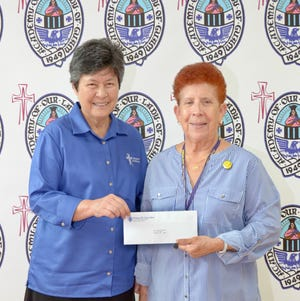 """The Academy of Our Lady of Guam was recently given a generous monetary donation from its alumna and faculty member, Dr. Judith Guthertz, class of 1964. The donation will go towards  purchasing a new sound system for the school gym. Pictured from left: Sr. Mary Angela Perez, RSM '64 AOLG president and Dr. Guthertz. The school is very appreciative and honored to have such caring alumna furthering the mission of their alma mater and carrying on the legacy of the """"sisterhood."""""""