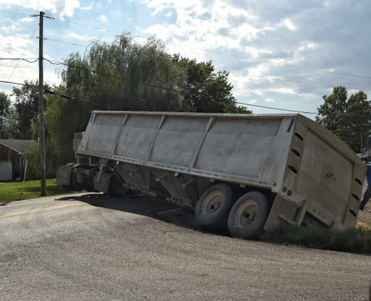 A Greenwell Farms truck is partially tipped over Tuesday, Sept. 18, 2018.
