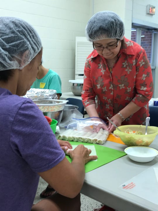 Eve Tiu packages eggrolls for the Holy Name Fall Festival.