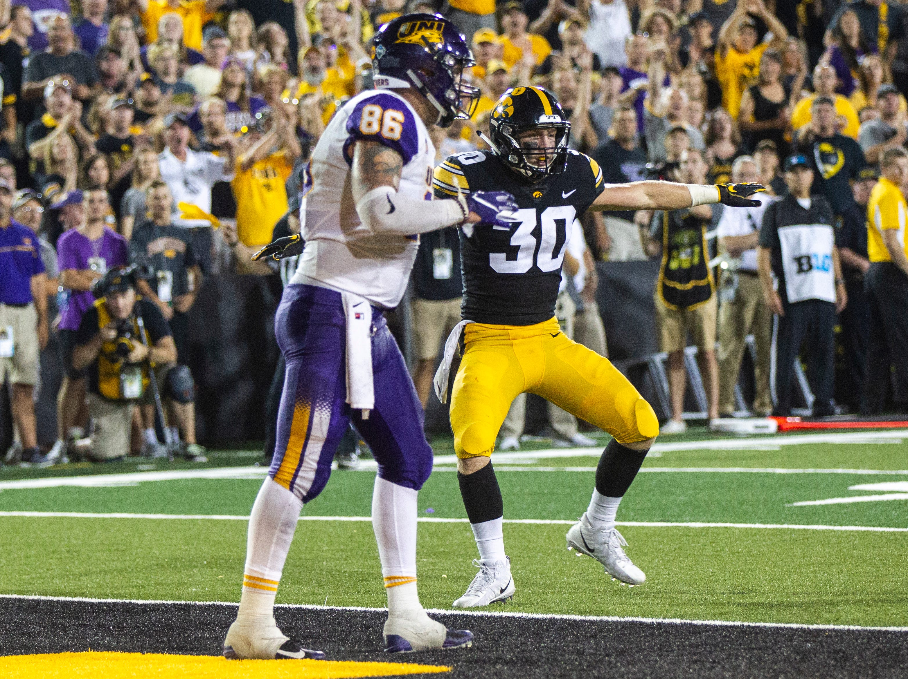 Iowa defensive back Jake Gervase (30) gestures after breaking up a pass intended for Northern Iowa tight end Briley Moore (86) during an NCAA football game on Saturday, Sept. 15, 2018, at Kinnick Stadium in Iowa City. Gervase was called for defensive pass interference on the play.