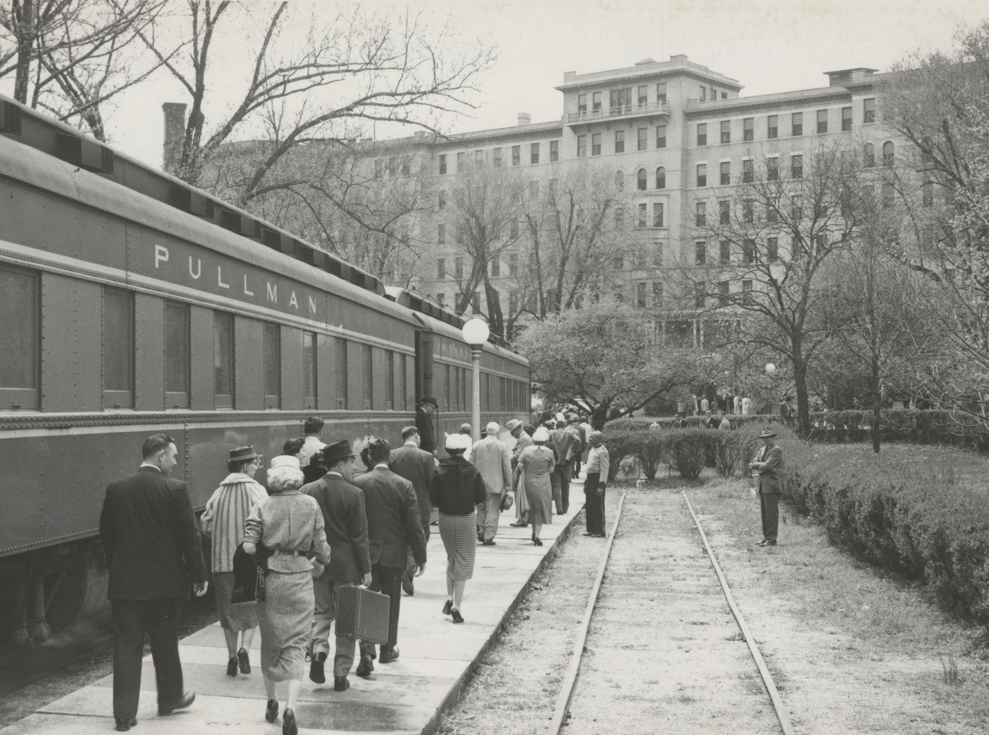 Pullman cars pull up to the French Lick Spring Hotel offloading guests to the hotel in the 1950s.