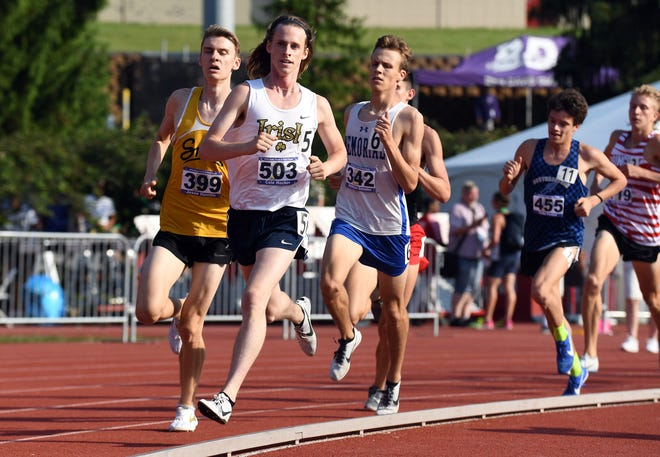 Cathedral's Cole Hocker leads a pack of runners in the 1600 meter run during the boys IHSAA track and field state finals at Robert C. Haugh Track and Field complex in Bloomington, May, 2, 2018.